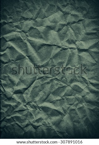 Green crumpled paper texture - stock photo