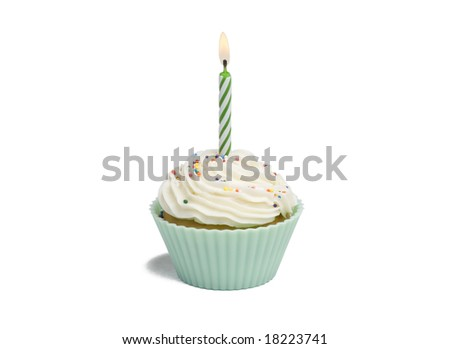 Green cupcake with candle on white background - stock photo