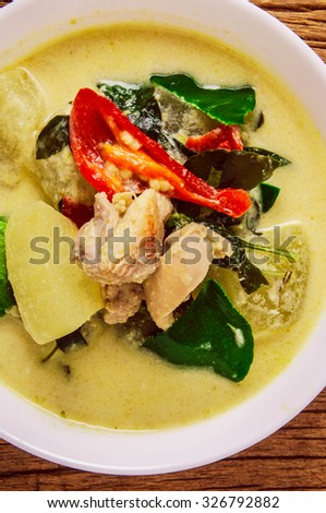 Green Curry, Thai Famous Cuisine. Homemade Fresh Food. Wood Background. Country Rustic Style. - stock photo
