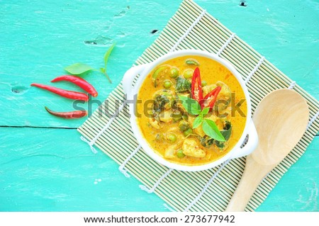 Green curry with chicken in bowl,Thai food. - stock photo