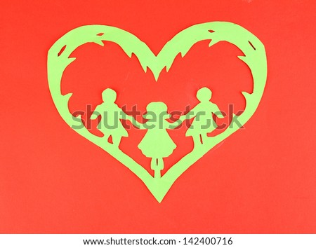 Green cut out paper heart with people inside, on color background