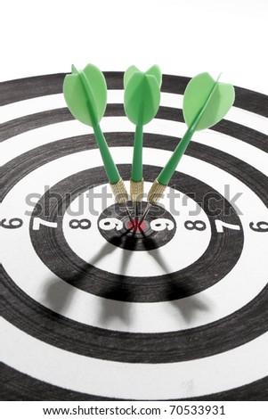 green darts on target - stock photo