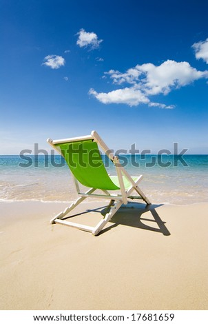 Green deck chair - stock photo