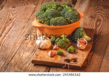 Green delicious broccoli on a wooden rustic table - stock photo