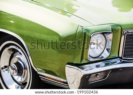 green detail on the headlight of a vintage car  - stock photo
