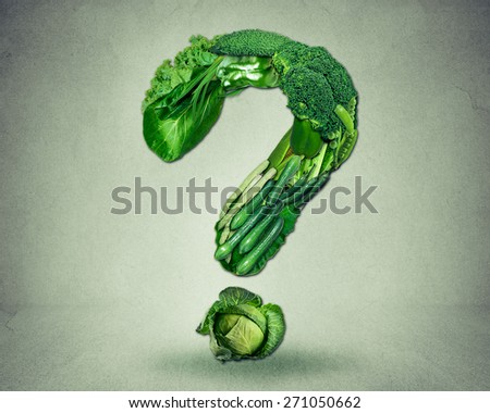 Green diet questions concept as a group of fresh fruit and vegetables in the shape of a question mark as a symbol of good high fiber healthy eating and information on natural nutrition. - stock photo