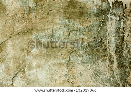Green dirty super-grunge background. Humid concrete wall with cracks, smudges and stains. - stock photo