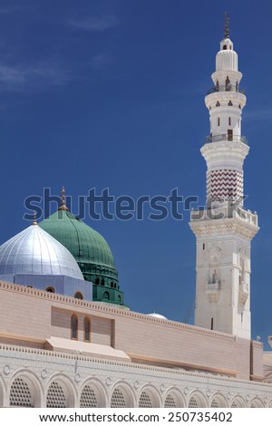 Green Dome and a Minaret of Masjid Nabawi - stock photo