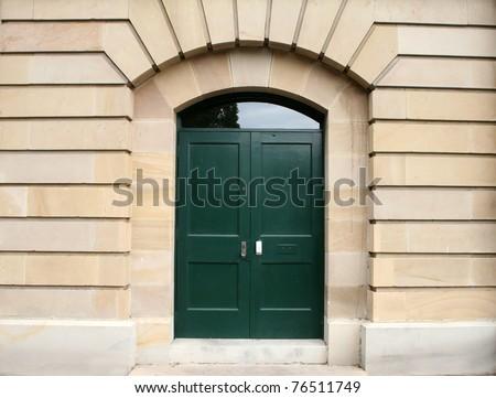 green door in a sandstone arch - stock photo