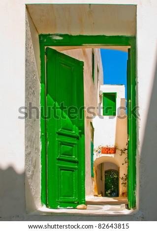 Green door in old Greek house in Mykonos Greece - stock photo
