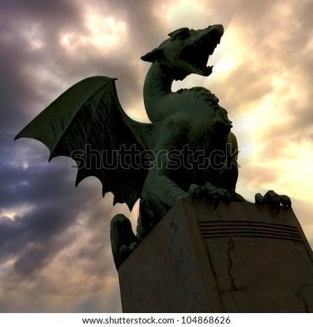 Green Dragon on the Dragon Bridge in capital city Ljubljana, Slovenia. The Dragon Bridge designed by the architect Jurij Zaninovi?, was erected in 1901 - stock photo