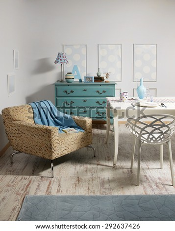 green drawers buffet ,white table, modern seat as vintage room - stock photo