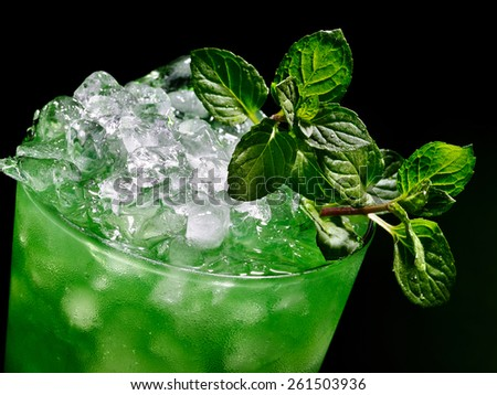 Green drink  with mint leaf on dark background. Top view. - stock photo
