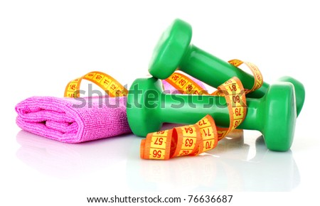 Green Dumbbells and tape measure  on the white background - stock photo