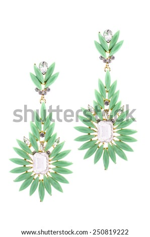 Green earrings inlaid with precious stones on a white background - stock photo