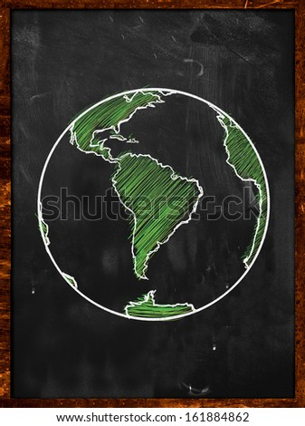 Green Earth on Blackboard - Globe background - stock photo
