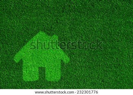 Green, eco friendly house, real estate concept. Overlay on grass background - stock photo