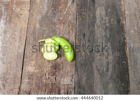 green eggplant  fresh vegetable  on a wooden table   - stock photo