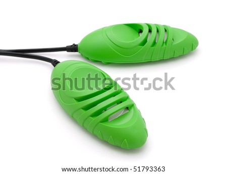 Green electric boot dryer isolated on white