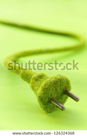 green electric plug , save energy concept