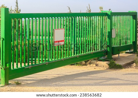 Green electrical gates - stock photo
