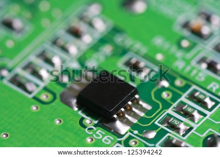 Green electronic PCB circuit background ,close up microchip CPU and component  electronic computer circuit board. electronics and IT technology manufacturing and business texture background