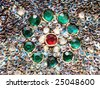 green encircled ruby embellishment - stock photo