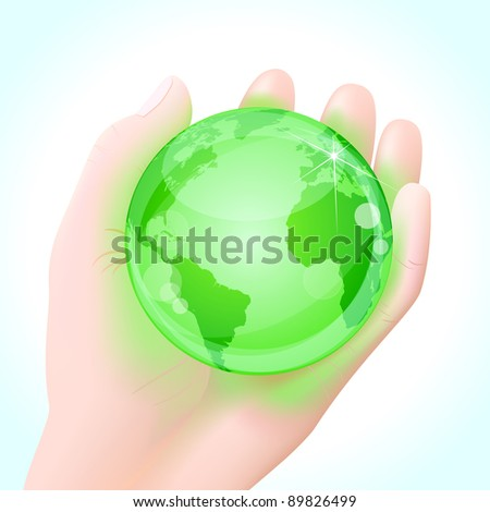 Green energy concept. Human hand holding a green glowing planet Earth globe.