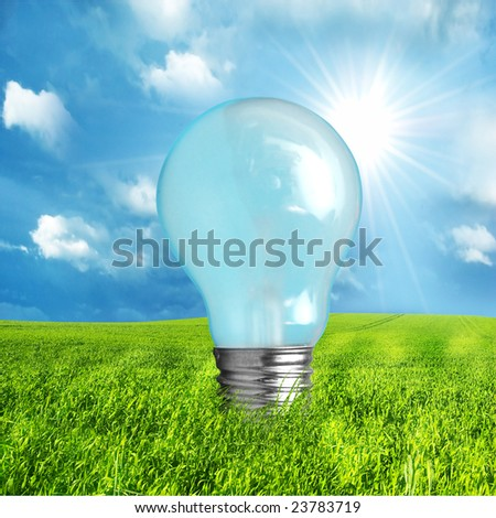 Green energy concept. Light bulb on nature background