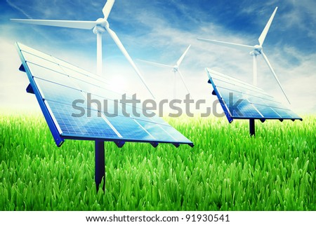 Green energy installation in a green field of grass - stock photo