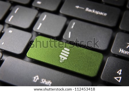Green energy key with eco bulb light icon on laptop keyboard. Included clipping path, so you can easily edit it.