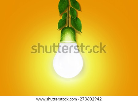 Green energy lamp, leaved cable - stock photo