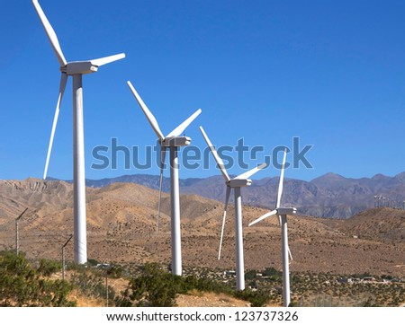 Green energy. Power wind mills turbine farm near Palm Springs, Ca,USA - stock photo