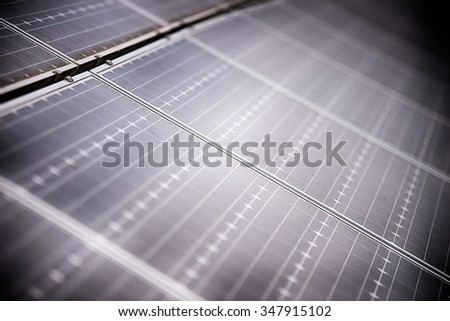 green energy solar panels on a cloudy day - stock photo