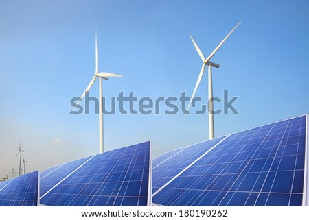 green energy wind mill turbine and solar system planets - stock photo