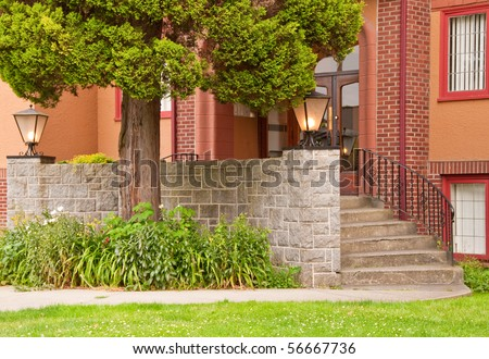 Green entrance of a condo in Vancouver, Canada. - stock photo
