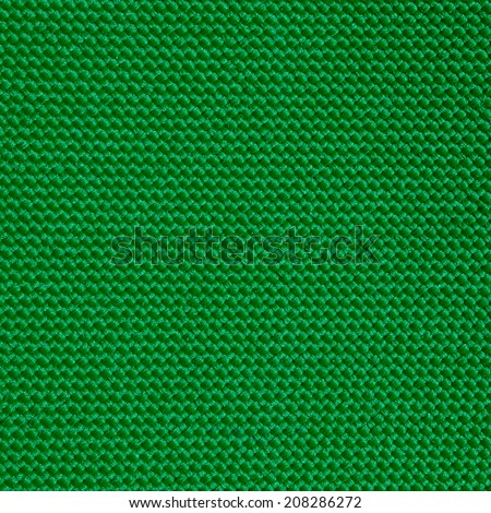 Green fabric stitched background texture closeup - stock photo