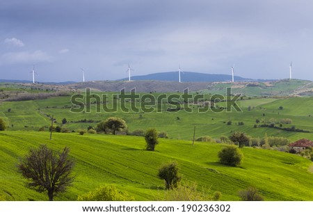 Green farms and wind turbines - stock photo
