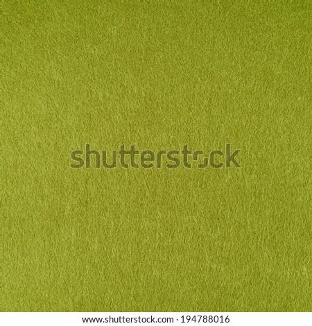 Green felt cloth fragment as a background texture - stock photo
