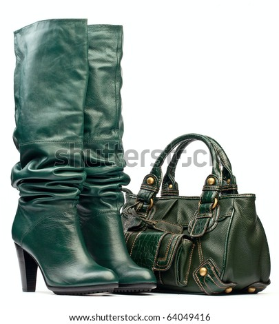 Green female high-heeled boots and leather bag - stock photo