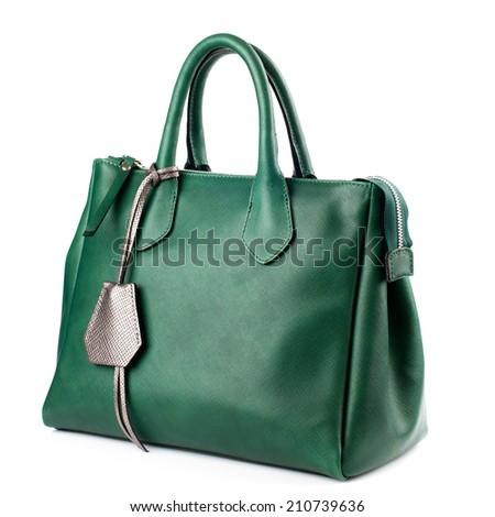 Green female leather bag isolated on white background. - stock photo