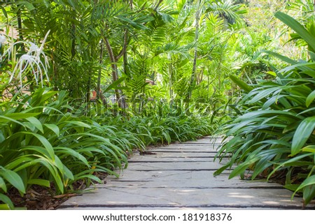green fence with green lawn - stock photo