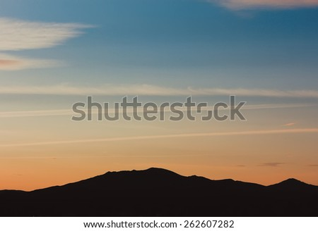 Green field and bright blue perfect sky with clouds. The mountains landscape, The hills in the fog. Morning and day green landscape, horizons. Summer background - stock photo