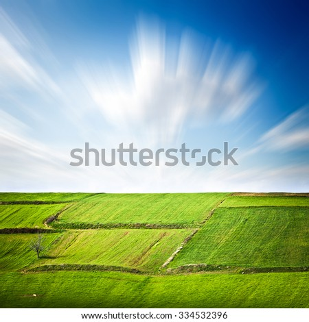 Green field and sky , long exposure photography. - stock photo