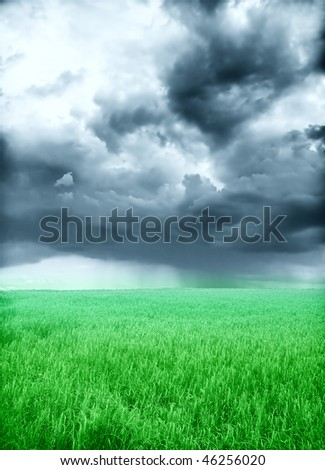 green field and storm