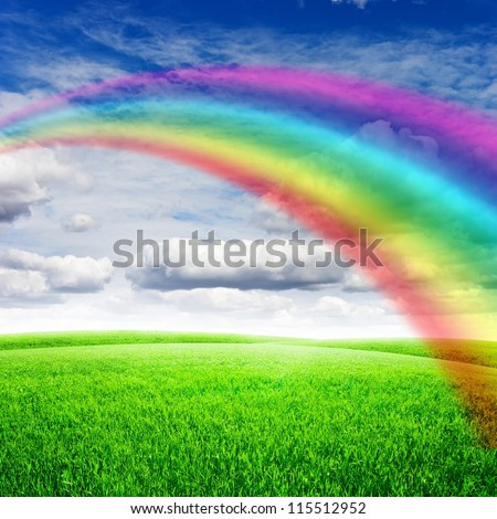 Green field under blue sky with sun and rainbow. Beauty nature background - stock photo