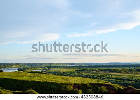 Green fields and hills scenic view - stock photo
