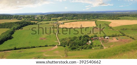 green fields near lulworth, dorset landscape, uk. - stock photo
