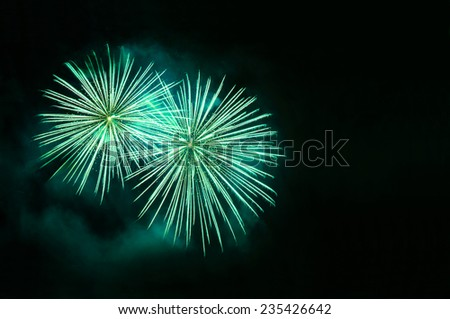 Green fireworks with copy space - stock photo