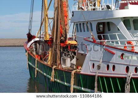 green fish boat or trawler for fishing - stock photo